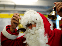 SARSTEDT, GERMANY - DECEMBER 24: A Syrian migrants dressed as Santa Claus prepares himself at a shelter for migrants and refugees on December 24, 2015 in Sarstedt, Germany. Thousands of Germans have volunteered in recent months at migrant shelters across the country as Germany seeks to cope with an influx …