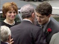 MONTREAL, CANADA:  Cuban President Fidel Castro (C) embraces Justin Trudeau (R), the son of former Canadian Prime Minister Pierre Trudeau, after arriving at the Notre Dame Basilica for Trudeau's state funeral 03 October 2000. Trudeau, who was considered to be one of Canada's most charismatic prime ministers, died of prostate cancer at age 80 at his home 28 September. Trudeau's ex-wife Margaret can be seen at left.  AFP PHOTO/JEFF KOWALSKY (Photo credit should read JEFF KOWALSKY/AFP/Getty Images)
