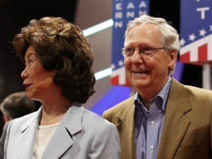 Senate Majority Leader Mitch McConnell (R-KY) (R), along with his wife Elaine Chao on July 17, 2016 in Cleveland, Ohio.
