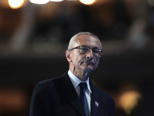 ohn Podesta, chair of the Hillary Clinton presidential campaign, walks off stage after delivering a speech on the first day of the Democratic National Convention at the Wells Fargo Center, July 25, 2016 in Philadelphia, Pennsylvania.