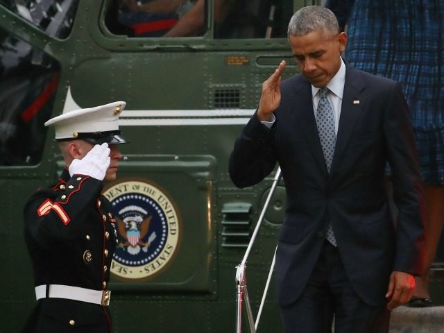 President Barack Obama salutes a U.S. Marine as he steps off of Marine One, after arriving back at the White House, September 28, 2016 in Washington, DC. Earlier today Congress voted to override President Obama's veto of legislation