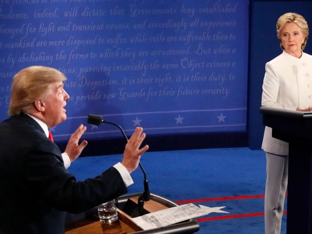 Republican nominee Donald Trump gestures as Democratic nominee Hillary Clinton looks on during the final presidential debate at the Thomas & Mack Center on the campus of the University of Las Vegas in Las Vegas, Nevada on October 19, 2016. / AFP / Mark RALSTON (Photo credit should read
