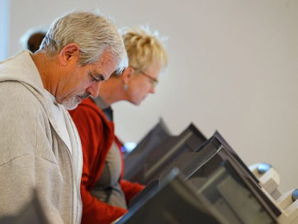 PROVO, UT - OCTOBER 25: People cast their ballots on electronic voting machines on the first day of early voting at the Provo Recreation Center, on October 25, 2016 in Provo, Utah. Early voting in the 2016 presidential election begins October 25 for Utah residents and is open until November …