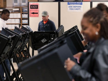 WINSTON-SALEM, NC - OCTOBER 28: Voters cast their ballots during early voting for the 2016 general election at Forsyth County Government Center October 28, 2016 in Winston-Salem, North Carolina. Early voting has begun in North Carolina through November 5. (Photo by Alex Wong/Getty Images)