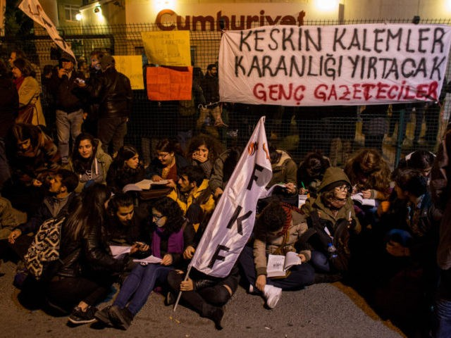 ISTANBUL, TURKEY - OCTOBER 31: People protest outside the Cumhuriyet Newspaper office after thirteen journalists including the editor-in chief were arrested on October 31, 2016 in Istanbul, Turkey. The Turkish prosecutors office has accused the journalists of helping the PKK and the Gulenist terror organisation. The opposition newspaper is Turkey's …
