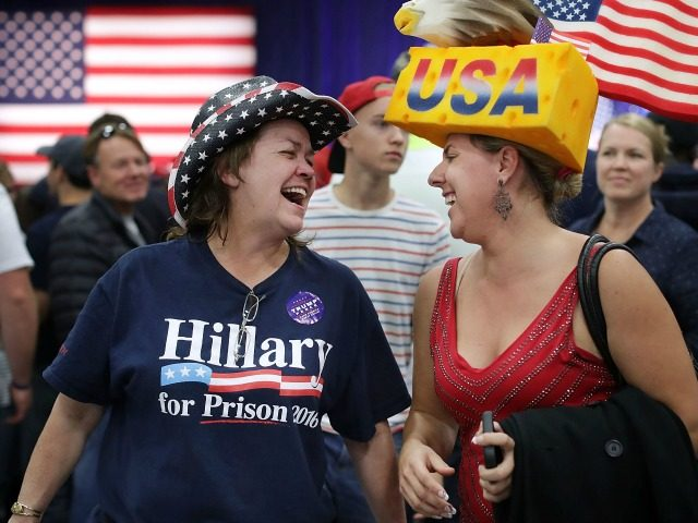 Cindy Hoffman (L) of Independence, Iowa, and Eric Smith of Cedar Rapids, Iowa, laugh together during a campaign rally for Republican presidential nominee Donald Trump at the W.L. Zorn Arena November 1, 2016 in Eau Claire, Wisconsin.