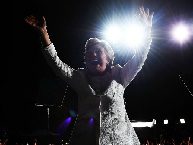 US Democratic presidential nominee Hillary Clinton waves to supporters during a campaign rally in Fort Lauderdale, Florida, on November 1, 2016. With one week to go until Election Day, Hillary Clinton and Donald Trump were barnstorming battleground states Tuesday, as the Democratic nominee tried to pivot away from attacks on …