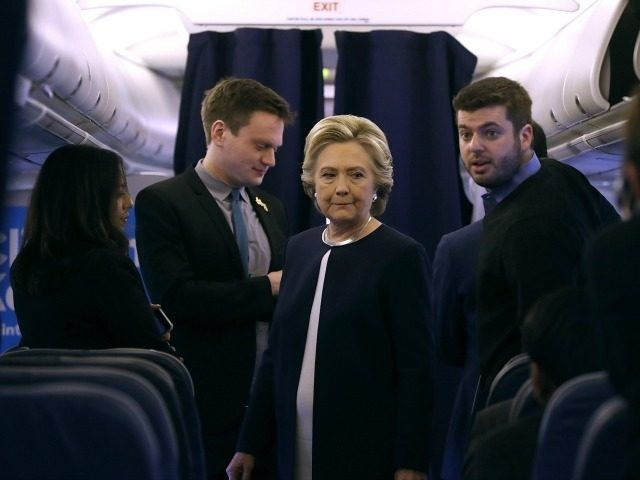 Democratic presidential nominee former Secretary of State Hillary Clinton talks with members of her staff aboard her campaign plane at Westchester County Airport on November 4, 2016 in White Plains, New York.