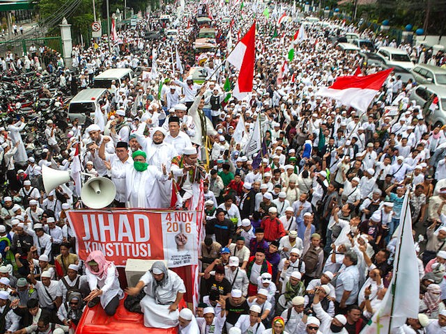 "JAKARTA, INDONESIA - NOVEMBER 04: Protesters march to the Merdeka Palace on November 4, 2016 in Jakarta, Indonesia. Indonesian police fired tear gas and water cannon to disperse hardline Muslim protesters outside the Presidential Palace in Jakarta, demanding for the city's Christian Governor Basuki T. Purnama to be prosecuted for alleged blasphemy. The accusation leveled against Jakarta Govneror Basuki ""Ahok"" Tjahaja Purnama, an ethnic Chinese, who is running in Indonesia's upcoming election, a country with the world's largest Muslim population. (Photo by Oscar Siagian/Getty Images)"