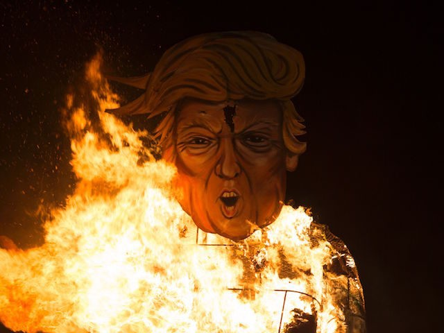 "Flames engulf an effigy of US presidential candidate Donald Trump as it is burned as the ""Celebrity Guy"" at the Edenbridge Bonfire Society bonfire night in Edenbridge, south of London, on November 5, 2016. DANIEL LEAL-OLIVAS/AFP/Getty Images"
