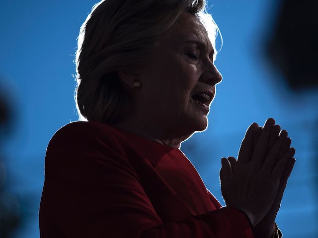 Democratic presidential nominee Hillary Clinton speaks during a rally outside the University of Pittsburgh's Cathedral of Learning November 7, 2016 in Pittsburgh, Pennsylvania. / AFP / Brendan Smialowski (Photo credit should read BRENDAN SMIALOWSKI/AFP/Getty Images)