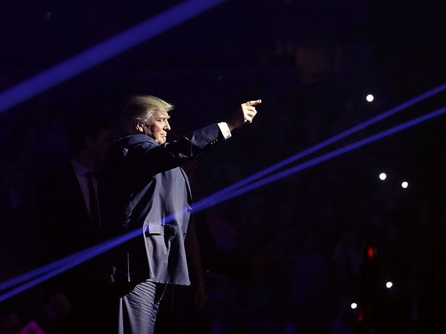 MANCHESTER, NH - NOVEMBER 07: Republican presidential nominee Donald Trump takes the stage with laser lights during a campaign rally at the SNHU Arena November 7, 2016 in Manchester, New Hampshire. With less than 24 hours until Election Day in the United States, Trump and his opponent, Democratic presidential nominee …