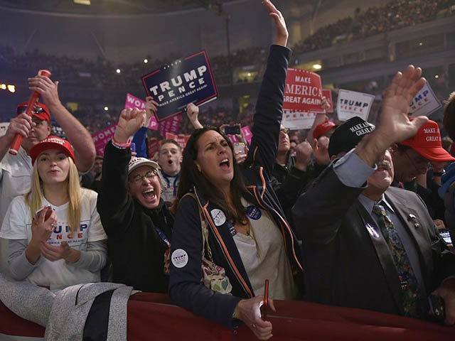 Supporters cheer as Republican presidential nominee Donald Trump addresses the final rally of his 2016 presidential campaign at Devos Place in Grand Rapids, Michigan on November 7, 2016. / AFP / MANDEL NGAN (Photo credit should read MANDEL NGAN/AFP/Getty Images)