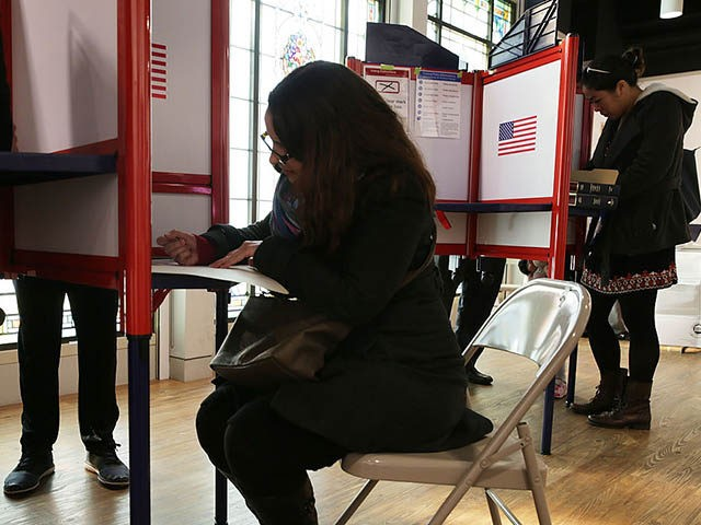 ARLINGTON, VA - NOVEMBER 08: Voters fill out their paper ballots in a polling place on election day November 8, 2016 in Arlington, Virginia. Americans across the nation make their choice for the next president of the United States today. (Photo by Alex Wong/Getty Images)