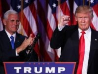 Republican president-elect Donald Trump acknowledges the crowd as Vice president-elect Mike Pence looks on November 9, 2016 in New York City.