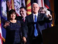 Vice president-elect Mike Pence walks on stage along with members of his family during Republican president-elect Donald Trump's election night event at the New York Hilton Midtown in the early morning hours of November 9, 2016 in New York City.