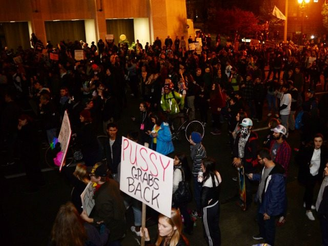 Demonstrators attend a protest against Donald Trump's US presidential election victory, at City Hall in Portland on November 11, 2016.