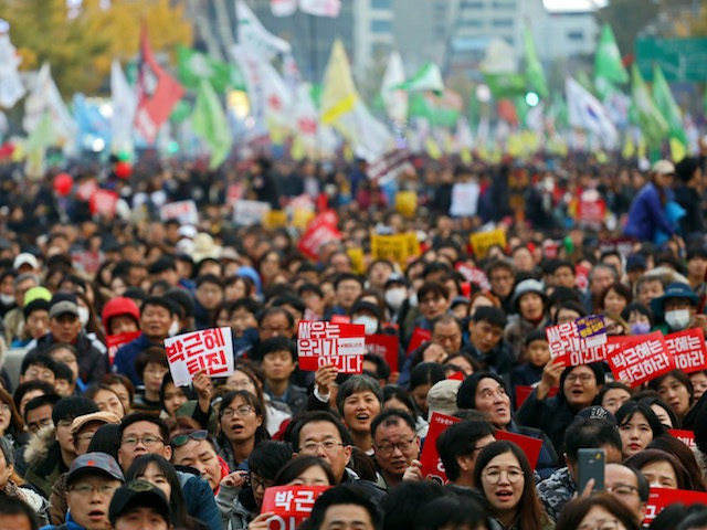 SEOUL, SOUTH KOREA - NOVEMBER 12: Thousands of South Koreans take to the streets in the city center to demand President Park Geun-Hye to step down on November 12, 2016 in Seoul, South Korea. Approximately tens of thousands of people joined the anti-government protest Saturday amid rising public frustration for …