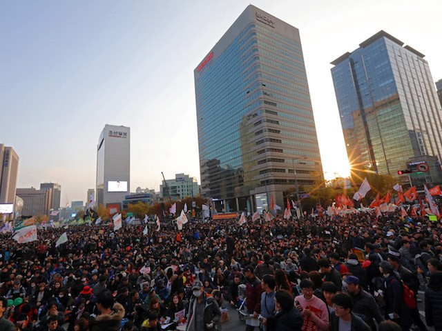 SEOUL, SOUTH KOREA - NOVEMBER 12: Thousands of South Koreans take to the streets in the city center to demand President Park Geun-Hye to step down on November 12, 2016 in Seoul, South Korea. Approximately tens of thousands of people joined the anti-government protest Saturday amid rising public frustration for President Park Geun-hye's corruption scandal. (Photo by Michael Heiman/Getty Images)