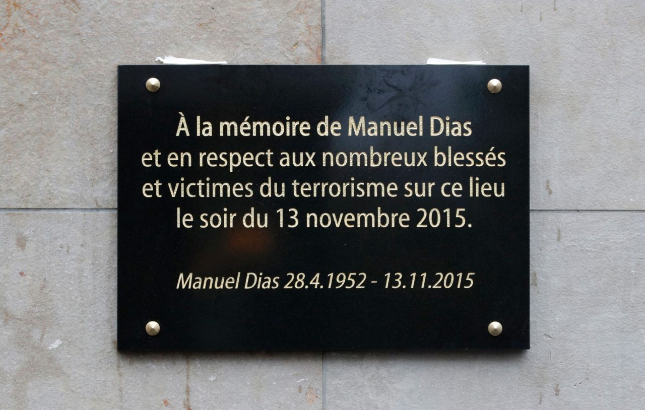 The lettering on a commemorative plaque reads 'To the memory of Manuel Dias and in respect of the numerous injured and victims of terrorism at this site on the evening of November 13, 2015' after the unveiling outside the Stade de France stadium, in Saint-Denis, north of Paris, on November 13, 2016, following a ceremony to mark the first anniversary of the Paris terror attacks. 130 people were killed on November 13, 2015 by gunmen and suicide bombers from the Islamic State (IS) group in a series of coordinated attacks in and around Paris. / AFP / POOL / PHILIPPE WOJAZER (Photo credit should read PHILIPPE WOJAZER/AFP/Getty Images)