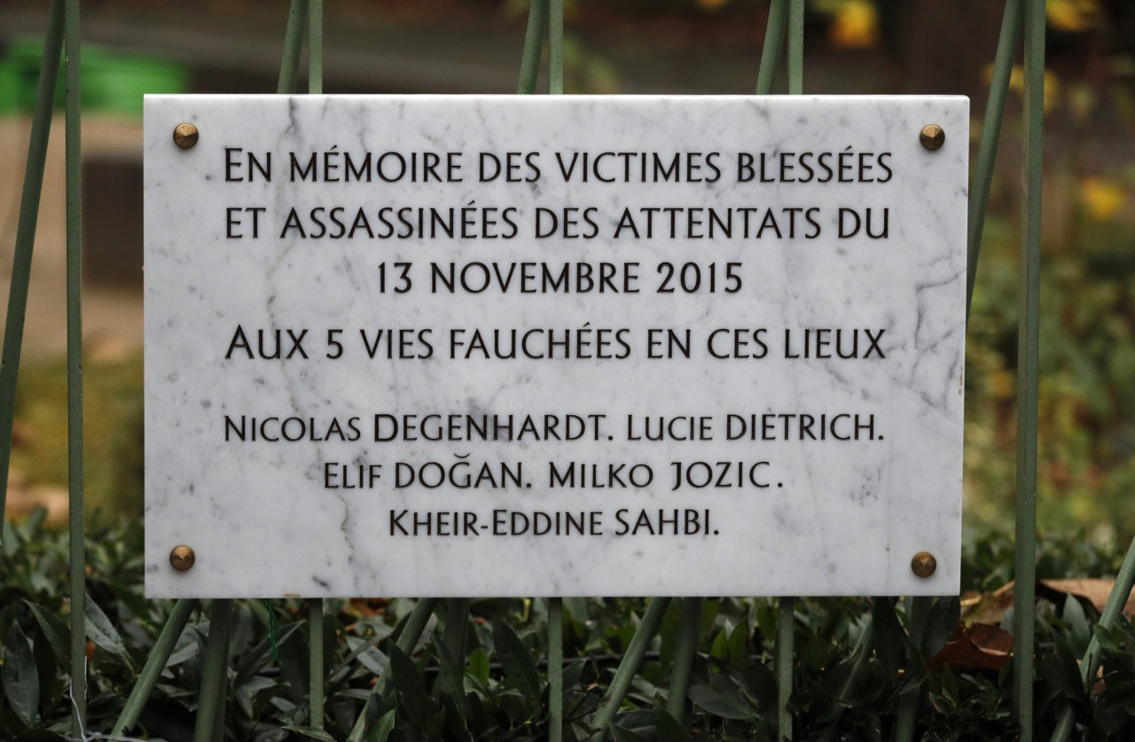 The lettering on a commemorative plaque reads 'In memory of the injured and killed victims of the attacks of November 13, 2015 - to the five lives taken in these places - Nicolas Degenhardt, Lucie Dietricdh, Elif Dogan, Milko Jozic, Kheir-Eddine Sahbi' after its unveiling next to the Cafe Bonne Biere and the Rue de la Fontaine au Roi street in Paris on November 13, 2016, during a ceremony to mark the first anniversary of the Paris terror attacks. 130 people were killed on November 13, 2015 by gunmen and suicide bombers from the Islamic State (IS) group in a series of coordinated attacks in and around Paris. / AFP / POOL / PHILIPPE WOJAZER (Photo credit should read PHILIPPE WOJAZER/AFP/Getty Images)