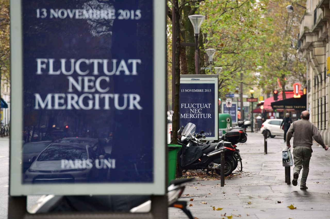 "Posters created by the city of Paris, reading ""Fluctuat Nec Mergitur"" (Tossed but not sunk) are seen in the streets of Paris, on November 13, 2016, for the first anniversary of the Paris terror attacks. 130 people were killed on November 13, 2015 by gunmen and suicide bombers from the Islamic State (IS) group in a series of coordinated attacks in and around Paris. / AFP / CHRISTOPHE ARCHAMBAULT (Photo credit should read CHRISTOPHE ARCHAMBAULT/AFP/Getty Images)"