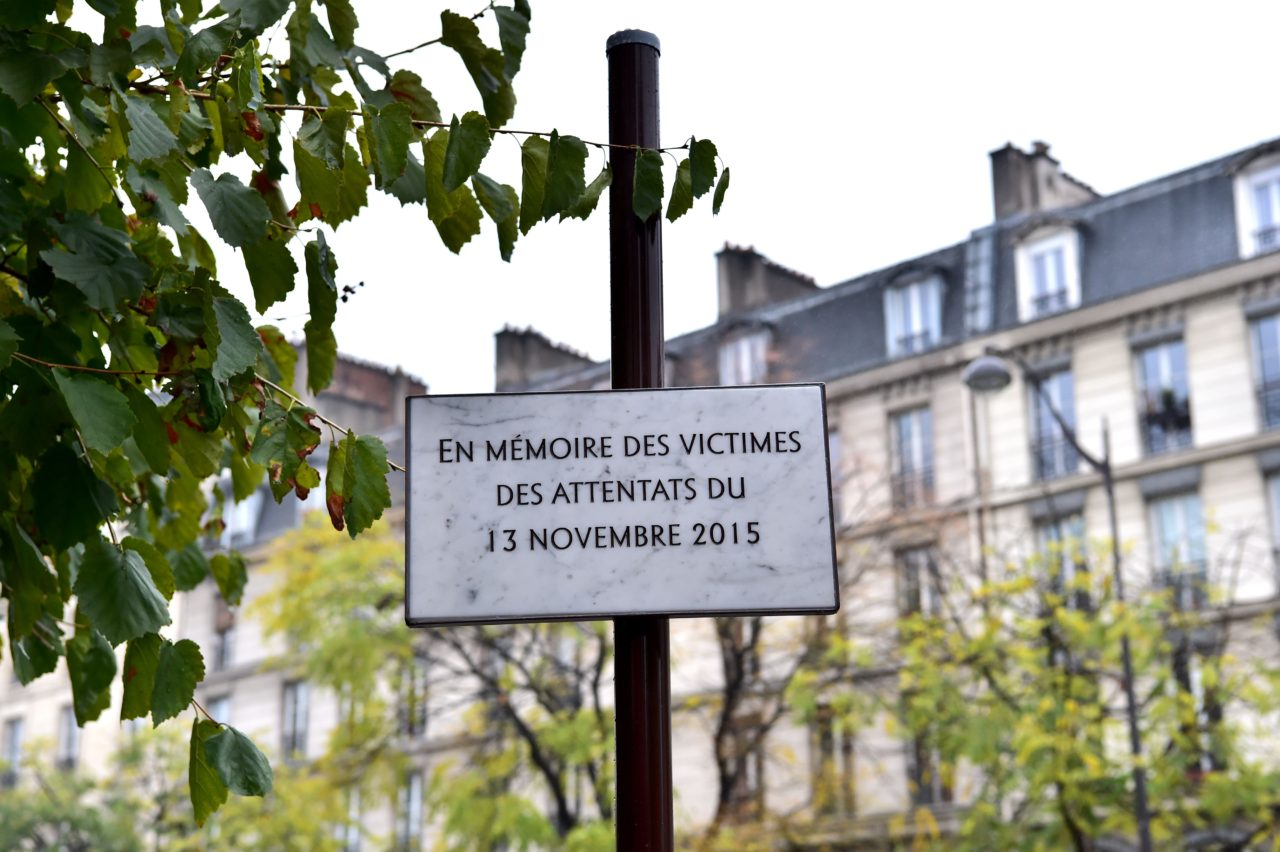 "The commemorative plaque reading ""'In memory of the victims of the attacks of November 13, 2015"" and unveiled by French President, is seen near the Cafe Comptoir Voltaire on Boulevard Voltaire, in Paris, on November 13, 2016, during a ceremony marking the first anniversary of the Paris terror attacks. 130 people were killed on November 13, 2015 by gunmen and suicide bombers from the Islamic State (IS) group in a series of coordinated attacks in and around Paris. / AFP / CHRISTOPHE ARCHAMBAULT (Photo credit should read CHRISTOPHE ARCHAMBAULT/AFP/Getty Images)"