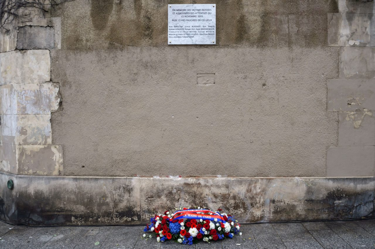 A wreath laid by French President is seen under a commemorative plaque in front of Le Petit Cambodge and Le Carillon restaurants at the junction of Rue Alibert and Rue Bichat in Paris, on November 13, 2016, after a ceremony marking the first anniversary of the Paris terror attacks. 130 people were killed on November 13, 2015 by gunmen and suicide bombers from the Islamic State (IS) group in a series of coordinated attacks in and around Paris. / AFP / POOL / Christophe Petit Tesson (Photo credit should read CHRISTOPHE PETIT TESSON/AFP/Getty Images)