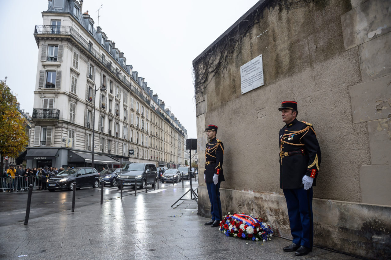 French Republican guards stand next to a wreath and a commemorative plaque unveiled by French President, in front of Le Petit Cambodge and Le Carillon restaurants at the junction of Rue Alibert and Rue Bichat in Paris, on November 13, 2016, during a ceremony marking the first anniversary of the Paris terror attacks. 130 people were killed on November 13, 2015 by gunmen and suicide bombers from the Islamic State (IS) group in a series of coordinated attacks in and around Paris. / AFP / Christophe Petit Tesson (Photo credit should read CHRISTOPHE PETIT TESSON/AFP/Getty Images)
