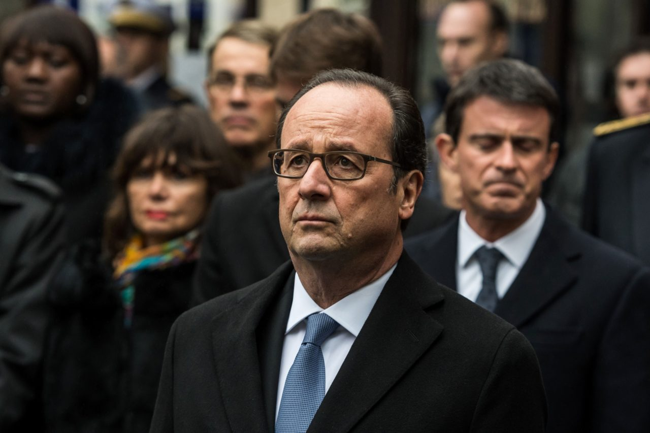 French President Francois Hollande (C) stands after unveiling a commemorative plaque in front of the Comptoir Voltaire cafe on Boulevard Voltaire in Paris on November 13, 2016, during a ceremony marking the first anniversary of the Paris terror attacks. 130 people were killed on November 13, 2015 by gunmen and suicide bombers from the Islamic State (IS) group in a series of coordinated attacks in and around Paris. / AFP / POOL / Christophe Petit Tesson (Photo credit should read CHRISTOPHE PETIT TESSON/AFP/Getty Images)