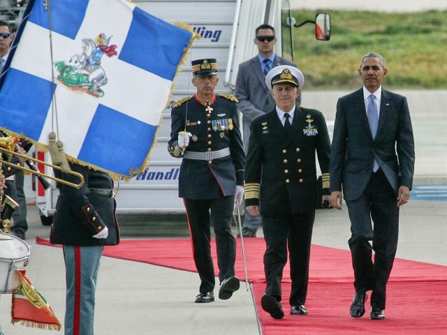 President Barack Obama walks with Greek National Defence Minister Panos Kammenos, right, and Admiral Evangelos Apostolakis, Chief of the Hellenic National Defence General Staff after his arrival at the Athens International Airport Eleftherios Venizelos on November 15, 2016 in Athens, Greece.