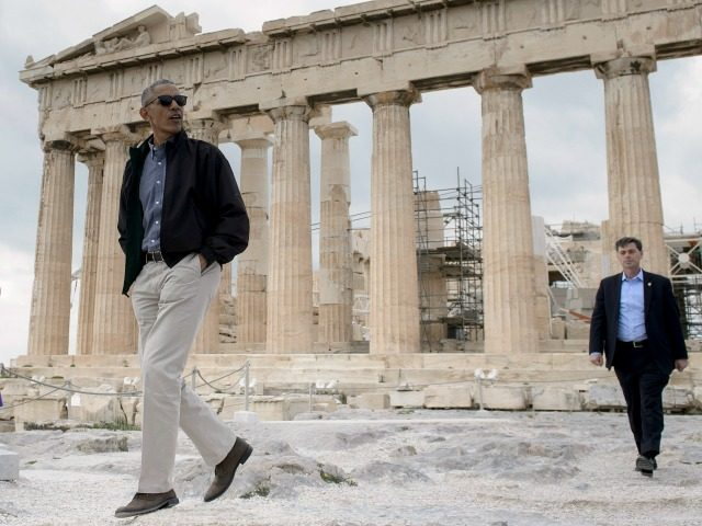 President Barack Obama (L) walks from the Parthenon during a tour of the Acropolis on November 16, 2016 in Athens, Greece. Obama will sketch out his vision of democracy at a time of mounting global populism, seeking to soothe European allies anxious over a Donald Trump presidency. / AFP / …
