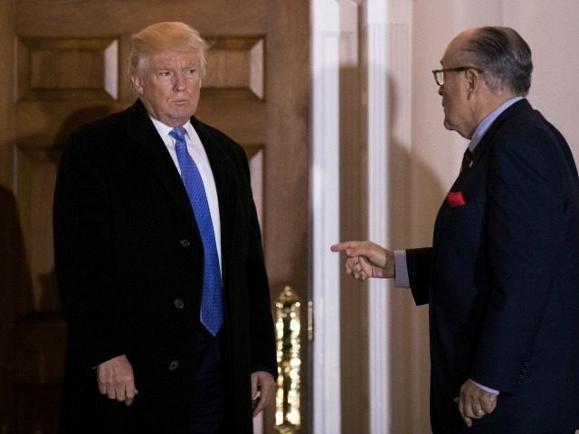 BEDMINSTER TOWNSHIP, NJ - NOVEMBER 20: (L to R) President-elect Donald Trump and former New York City mayor Rudy Giuliani talk to each other as they exit the clubhouse following their meeting at Trump International Golf Club, November 20, 2016 in Bedminster Township, New Jersey. Trump and his transition team …