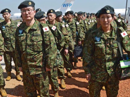 Members of the Japanese Ground Self-Defence Force (GSDF) arrive at the airport in Juba, South Sudan, on November 21, 2016. A United Nations plane landed in the morning at Juba airport with 60 new Japanese peacekeepers as the first group of the 350-strong unit, which will replace the current Japanese …