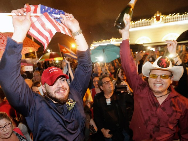 Cuban Americans celebrate upon hearing about the death of longtime Cuban leader Fidel Castro in the Little Havana neighborhood of Miami, Florida on November 26, 2016. Cuba's socialist icon and father of his country's revolution Fidel Castro died on November 25 aged 90, after defying the US during a half-century of ironclad rule and surviving the eclipse of global communism. / AFP / RHONA WISE (Photo credit should read RHONA WISE/AFP/Getty Images)