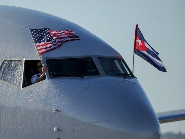 American Airlines plane fluttering US and Cuba national flags is seen uppon arrival at Jose Marti International Airport becoming the first Miami-Havana commercial flight in 50 years, coinciding with the beginning of the tributes to late Cuban leader Fidel Castro, on November 28, 2016 in Havana. / AFP / YAMIL …