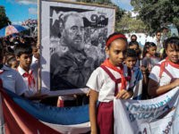 Children pay their last respects to Cuban revolutionary icon Fidel Castro in Bayamo, Granma province, on November 28, 2016.  A titan of the 20th century who beat the odds to endure into the 21st, Castro died late Friday after surviving 11 US administrations and hundreds of assassination attempts. No cause of death was given. Castro's ashes will go on a four-day island-wide procession starting Wednesday before being buried in the southeastern city of Santiago de Cuba on December 4. / AFP / STR        (Photo credit should read STR/AFP/Getty Images)
