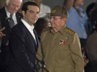 Cuban President Raul Castro (C-R) stands next to Greece's Prime Minister Alexis Tsipras (C-L) during a massive rally at Revolution Square in Havana in honor of late leader Fidel Castro. Castro -- who ruled from 1959 until an illness forced him to hand power to his brother Raul in 2006 -- died Friday at age 90. The cause of death has not been announced. / AFP / JUAN BARRETO        (Photo credit should read JUAN BARRETO/AFP/Getty Images)
