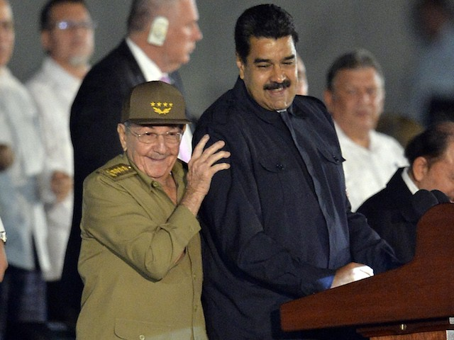 Cuban President Raul Castro (L) stands with Venezuelan President Nicolas Maduro (R) during a massive rally on November 29, 2016 on Revolution Square in Havana in honor of the late Cuban leader Fidel Castro. Fidel Castro -- who ruled from 1959 until an illness forced him to hand power to his brother Raul in 2006 -- died Friday at age 90. The cause of death has not been announced. / AFP / PEDRO PARDO (Photo credit should read PEDRO PARDO/AFP/Getty Images)