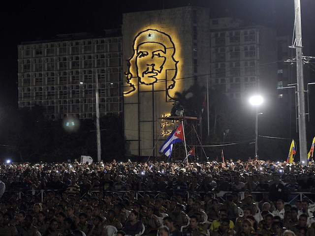 TOPSHOT - People participate in a massive rally on Revolution Square November 29, 2016 in Havana in honor of late leader Fidel Castro. Fidel Castro -- who ruled from 1959 until an illness forced him to hand power to his brother Raul in 2006 -- died Friday at age 90. The cause of death has not been announced. / AFP / PEDRO PARDO (Photo credit should read PEDRO PARDO/AFP/Getty Images)
