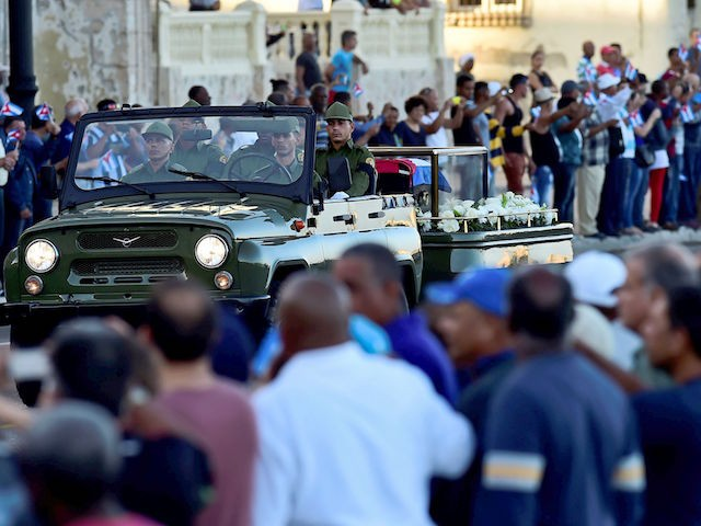 """The urn with the ashes of Cuban leader Fidel Castro is driven through the streets of Havana starting a four-day journey across Cuba, on November 30, 2016. The """"caravan of freedom"""" will leave from Havana, making symbolic stops along the 950-kilometer (590-mile) trek that will end in the eastern city of Santiago de Cuba over the weekend. / AFP / Ronaldo SCHEMIDT (Photo credit should read RONALDO SCHEMIDT/AFP/Getty Images)"""
