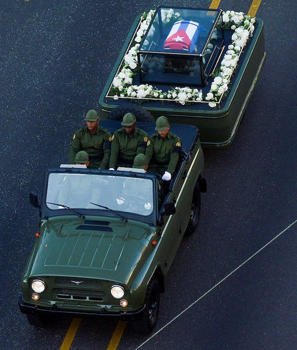 """The urn with the ashes of Cuban leader Fidel Castro is driven through the streets of Havana starting a final four-day journey across Cuba, on November 30, 2016. The """"caravan of freedom"""" will leave from Havana, making symbolic stops along the 950-kilometer (590-mile) trek that will end in the eastern city of Santiago de Cuba over the weekend. / AFP / STR (Photo credit should read STR/AFP/Getty Images)"""