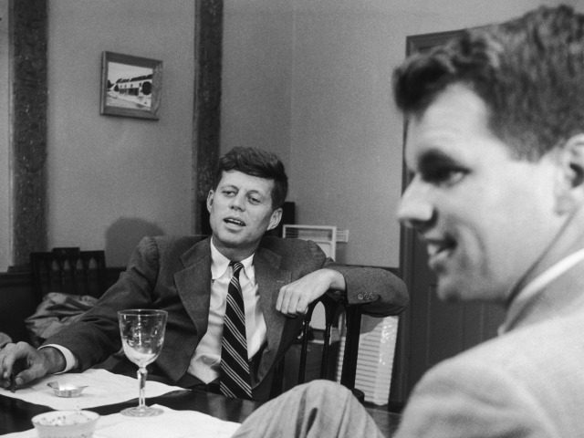 Senator John F. Kennedy (1917 - 1963, left) at his home in Georgetown, Massachusetts, with his brother Robert (1925 - 1968), 1955. A painting by John Kennedy hangs on the wall behind him. (Photo by )
