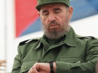 (FILES) Cuban President Fidel Castro checks his watch while watching the traditional Labor Day parade attended by thousands of people in Havana's Plaza of the Revolution, May 1, 1998. Castro resigned on February 19, 2008 as president and commander in chief of Cuba in a message published in the online …