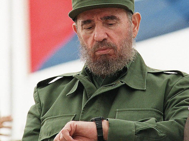 (FILES) Cuban President Fidel Castro checks his watch while watching the traditional Labor Day parade attended by thousands of people in Havana's Plaza of the Revolution, May 1, 1998. Castro resigned on February 19, 2008 as president and commander in chief of Cuba in a message published in the online version of the official daily Granma.       AFP PHOTO/Adalberto ROQUE (Photo credit should read ADALBERTO ROQUE/AFP/Getty Images)