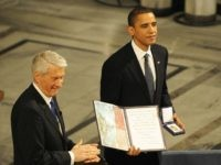 Chairman of the Norwegian Nobel Committee Thorbjoern Jagland (L) applauses as laureate, US President Barack Obama hands the diploma and medal to Nobel Peace Prize, during the Nobel Peace prize award ceremony at the City Hall in Oslo on December 10, 2009.