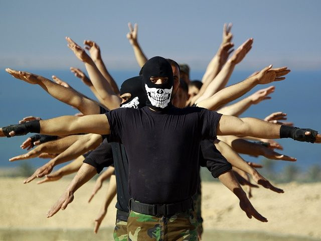 Fighters from the Iraqi Imam Ali Brigade, take part in a training exercise in Iraq's central city of Najaf on March 7, 2015, ahead of joining the military operation in the city of Tikrit. Some 30,000 Iraqi security forces members and allied fighters launched an operation to retake Tikrit at …