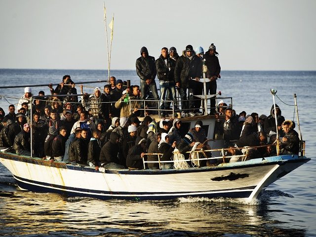 A boat full of would be immigrants is seen near the Italian island of Lampedusa on March 7, 2011. A total of 155 immigrants landed on the Italian island of Lampedusa early Monday and customs police patrolling the Strait of Sicily by air sighted eight other boats on their way.AFP PHOTO / ROBERTO SALOMONE (Photo credit should read ROBERTO SALOMONE/AFP/Getty Images)