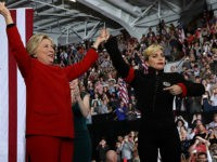 Democratic presidential nominee former Secretary of State Hillary Clinton (C) raises her arms with musicians Jon Bon Jovi (L) and Lady Gaga during a campaign rally at North Carolina State University on November 8, 2016 in Raleigh North Carolina. With one day to go until election day, Hillary Clinton is …