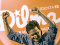 Former Minister of Fishery and candidate for Rio de Janeiro's gubernatorial election, Marcelo Crivella, of the Brazilian Republican Party (PRB) gestures during a campaign gathering with Brazil's President Dilma Rousseff (out of frame), of the Workers' Party (PT) and candidate for reelection, in Duque de Caxias, suburb of Rio, Brazil, …